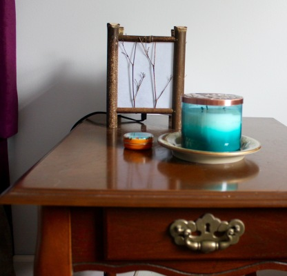 And another candle on the bedside table with some Rosebud Perfume Co. mandarin orange lip balm.